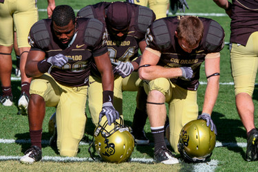 CU Players kneel before a game.  Invisiblesmiley (c)2020