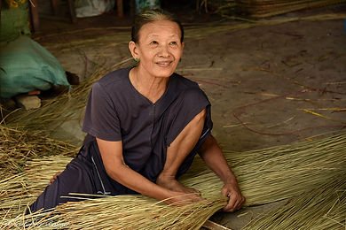 Image of woman with weeds by Christopher Balmer on China Photo Tour