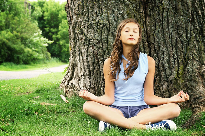 Teenager doing yoga and relaxing by siti