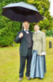 Two people dressed in period costumes for Talking Tombstones event