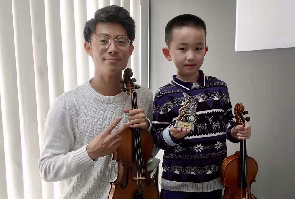 With his violin teacher and idol, Monty