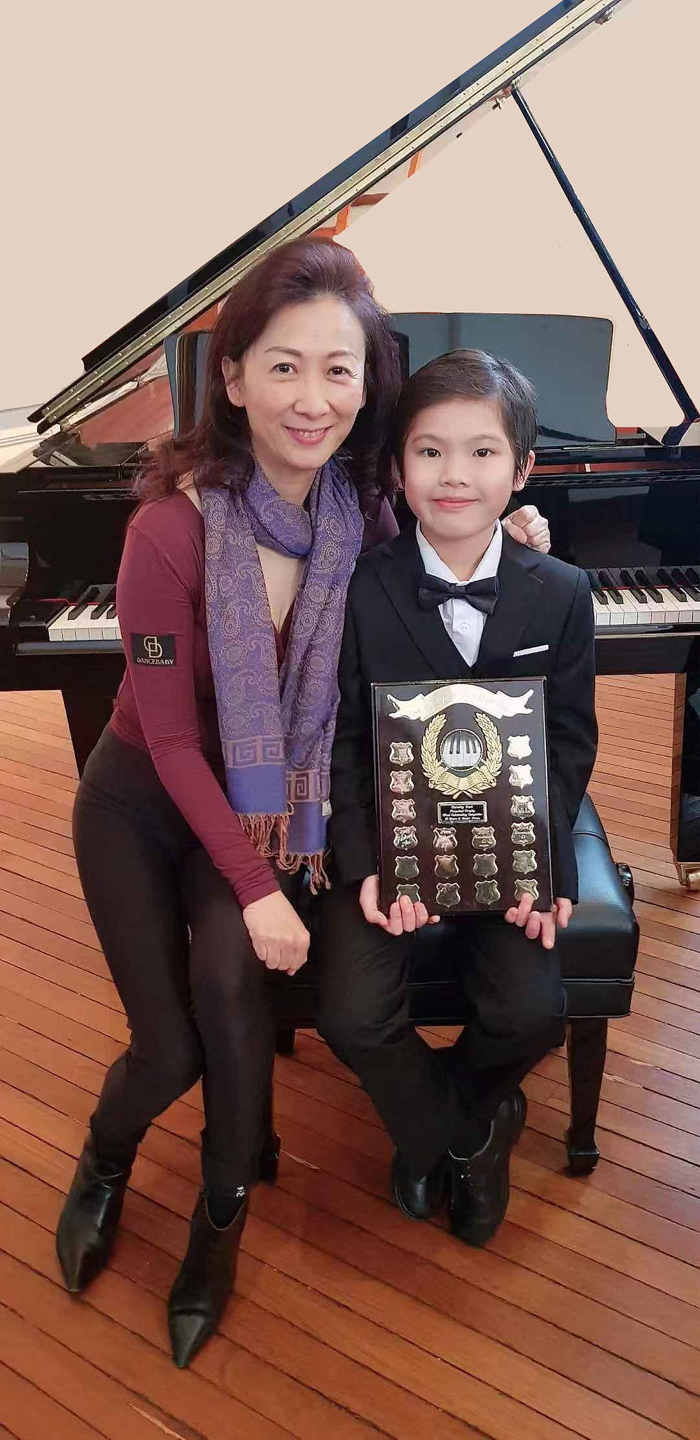 """Isaiah with his piano teacher Lily who was at the Eisteddfod to support his performance. Isaiah was most appreciative of this dedicated teacher, as he said: """"I received the most outstanding award because I have the most outstanding piano teacher."""""""