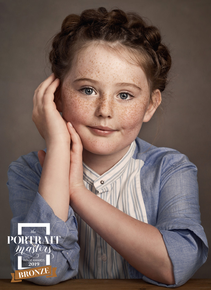 Little girl with freckles TPM 2019