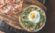 Close up wood stone pizzas with fresh ingredients
