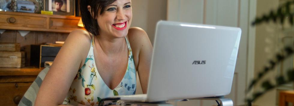 House 2 Tess on computer smiles.jpg
