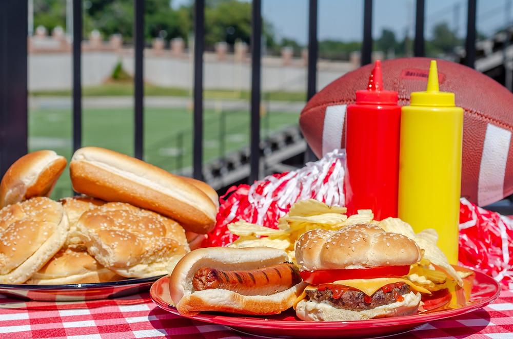 Hamburgers and football on table