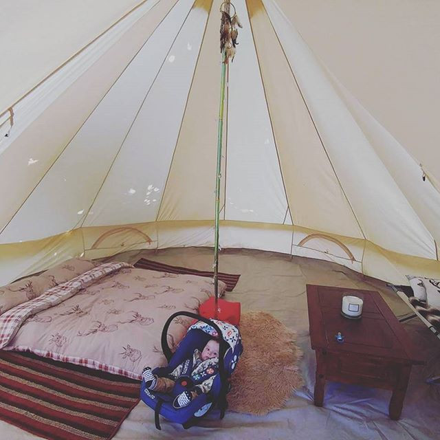 Baby camping in a yurt tipi