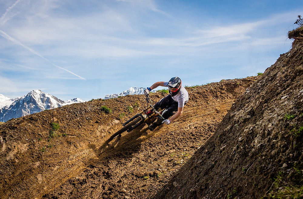 Andras riding downhill bike in Champery Bike Park