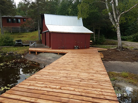 A new dock at Sasseginaga Outpost's boat launch where guests find a remote fishing lodge in Quebec, Canada. Come experience trophy walleye fishing. Trophy northern pike and lake trout are caught too. Sasseginaga Outpost Lodge on Lake Sasseginaga is a Canadian fishing outfitter that's off grid with house keeping conveniences of home. Sasseginaga Outpost is located in west central Quebec just short drive from Ontario, Canada. The nearerst town is Temiscaming along the Ottawa river in Quebec. Nearby Sassegianga Outpost is Lake Ogascanan's Lodge, Camp Coucoushee on lake Kikwissi, Bush Country Camp, Lake Pomeroy and Lake Kipawa. Lake Sasseginaga is located within the ZEC Kipawa