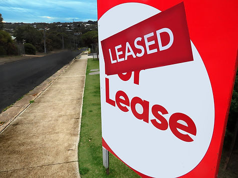 House for lease sign in front of a home