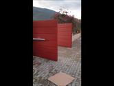 Αυτόματη ανοιγόμενη μεταλλική πόρτα με δύο φύλλα από την ΧΡΙΣΤΑΚΟΣ ΜΕΤΑΛΛΟ ΚΑΙ ΔΟΜΗΣΗ