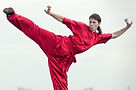 Man in Red Practicing Kung Fu