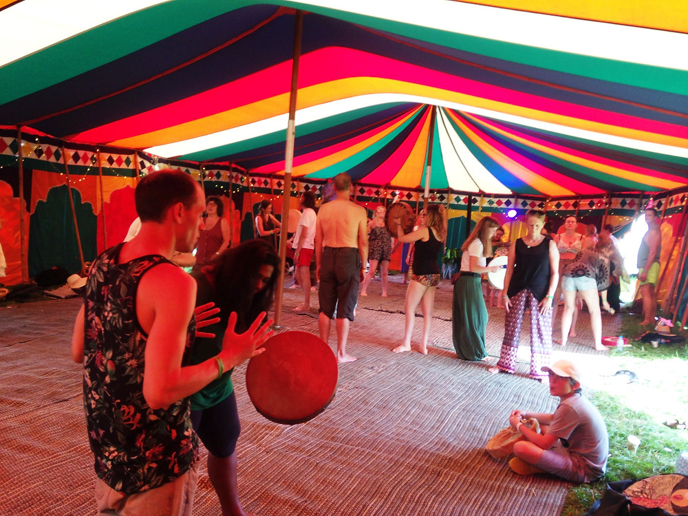 A huge marquee and people drumming in pairs