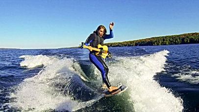 dude-shreds-on-guitar-while-surf.jpg