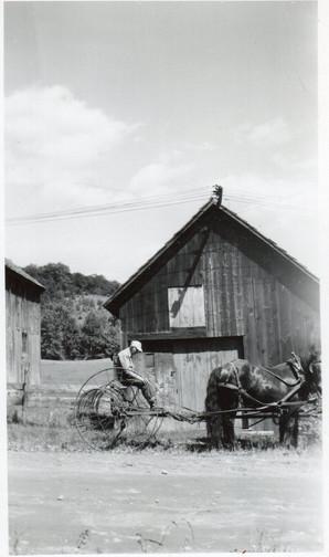 Earl Boyce on dump rake, In front of cor