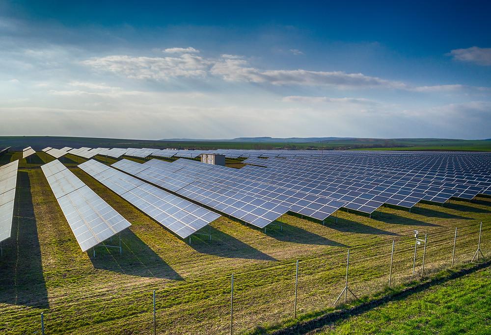Solar Panel Farm on a sunny day with blue sky  by Gus Garcia