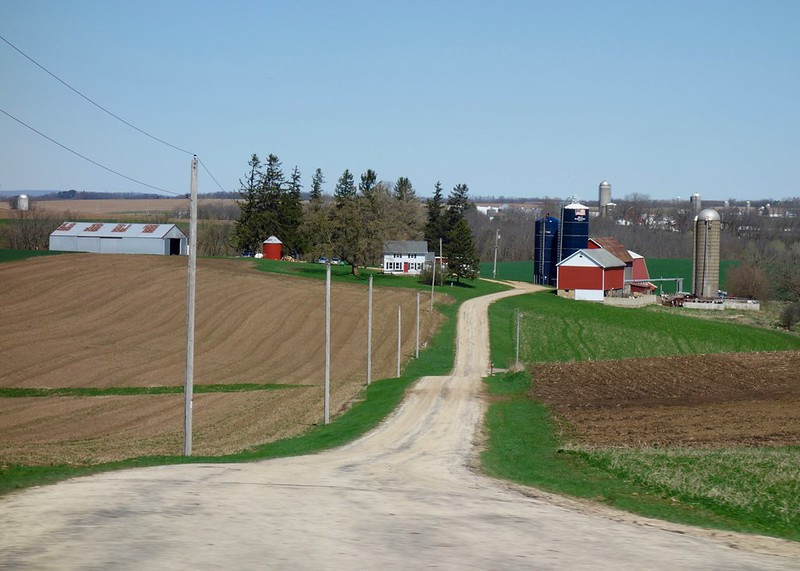 Farm scene with open fields and buildings.  Image by L. Shanley