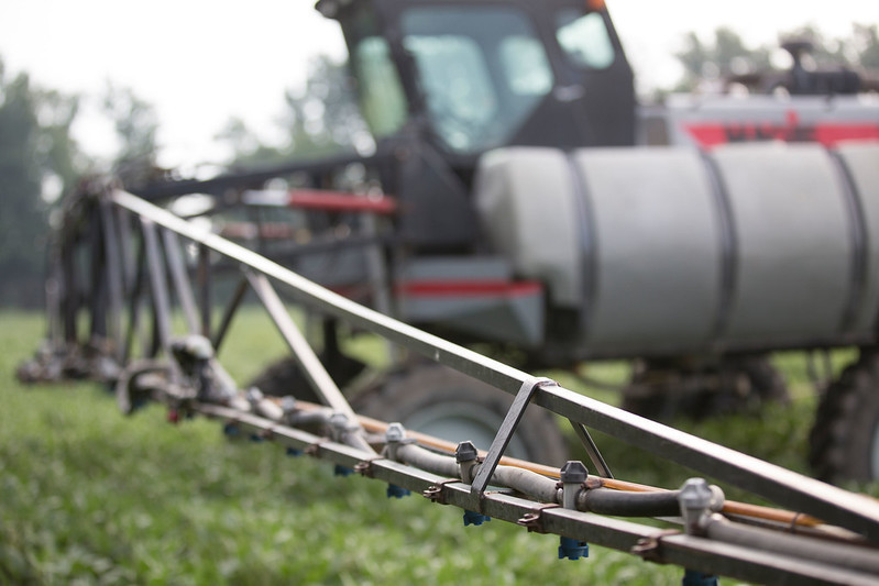 Sprayer in field by United Soybean Board and the Soybean Checkoff