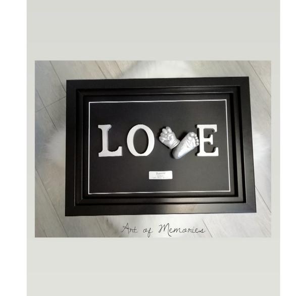 Love Abdruck Schwarzer Rahmen mit Silber Händchen-und Füsschenabdrück in 3D
