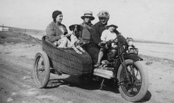 A family on a motorcycle with a sidecar on the beach in Morocco, 1936