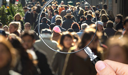People seen through magnifying glass