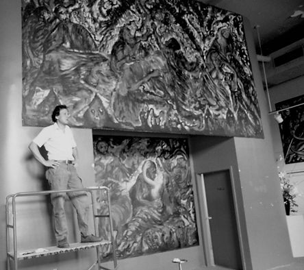 Kanso stands atop a scaffold with two large paintings, black-and-white photograph.