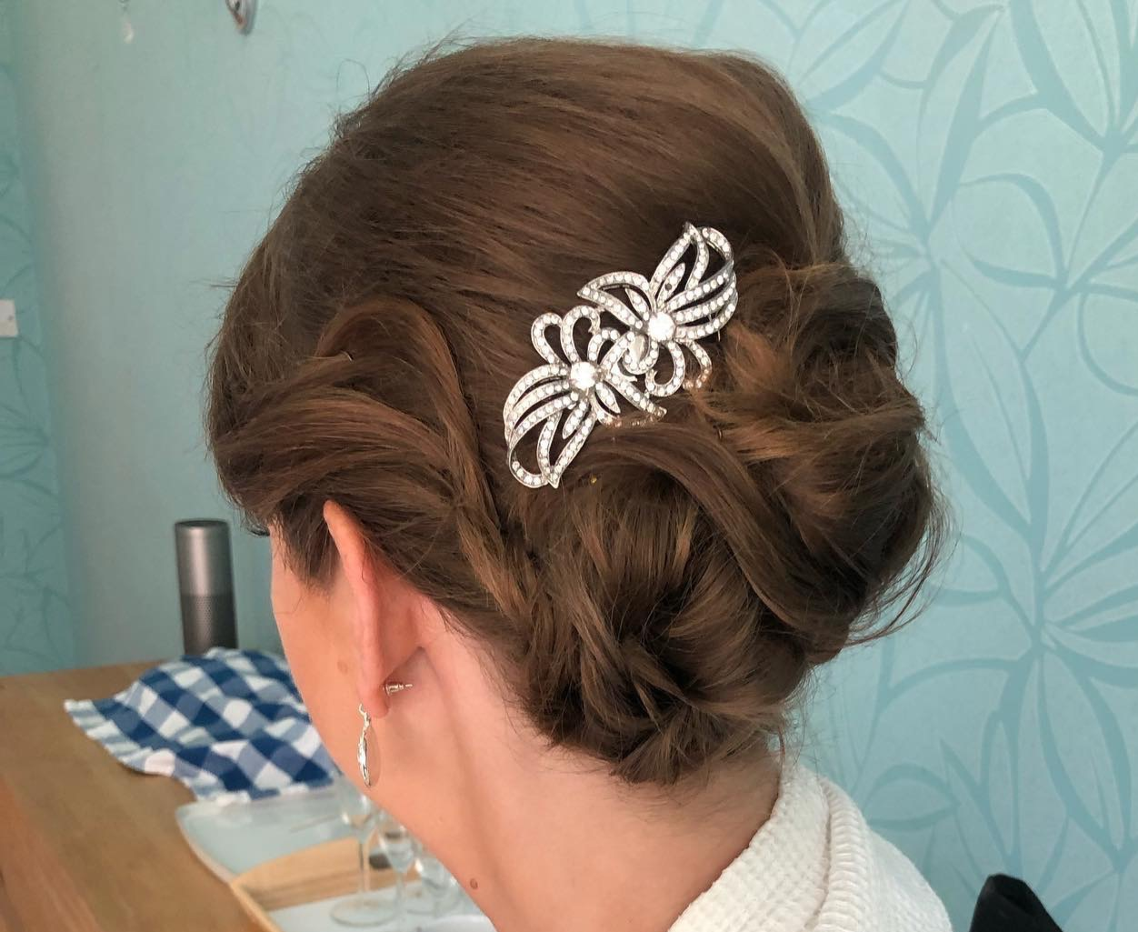 Wedding guest up-do with pin