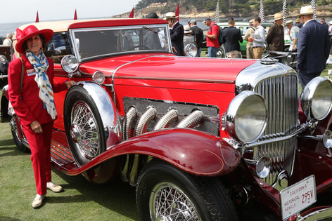 Valerie Weiss at Pebble Beach with her 1931 Duesenberg J LeBaron Convertible, wearing our multicolor Delahaye scarf