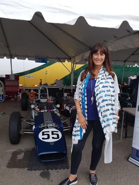 Angie Drake wearing the Bugatti scarf to brighten up the pitt lane