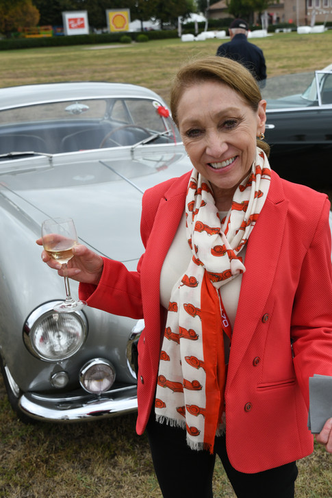 Sissy Muldoon wearing the Ferrai scarf while toasting her class win at Maranello at Ferrari's 70th Anniversary Concorso.