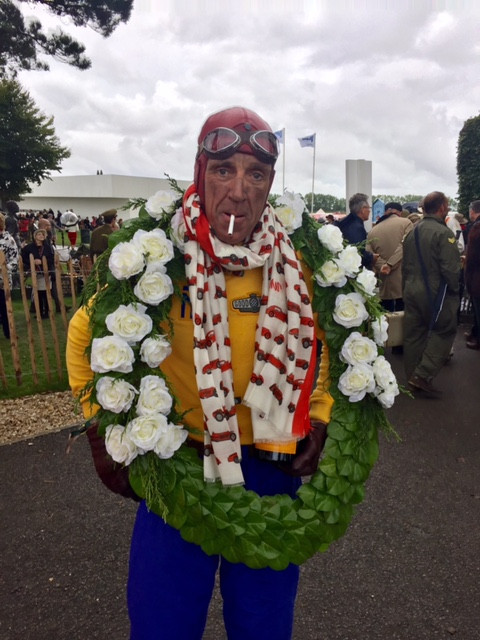 """""""Tazio Nuvolari"""" wearing our Alfa Romeo scarf in the winner's circle at the Goodwood Revival 2016"""