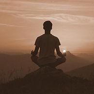 man-meditating-mountaintop-sunset_sepia_