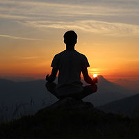 man-meditating-mountaintop-sunset_dharm-
