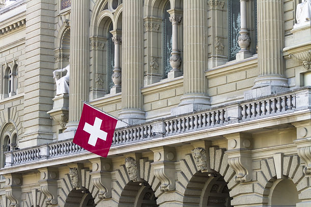 Swiss flag infront of building