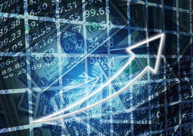 Notas de dólar ao fundo e gráfico ascendendo