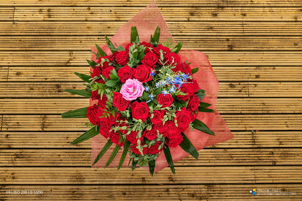 45 Red Roses on a wooden backdrop