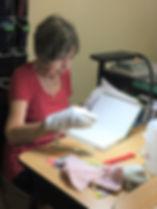 Irene Inspecting Books.jpg