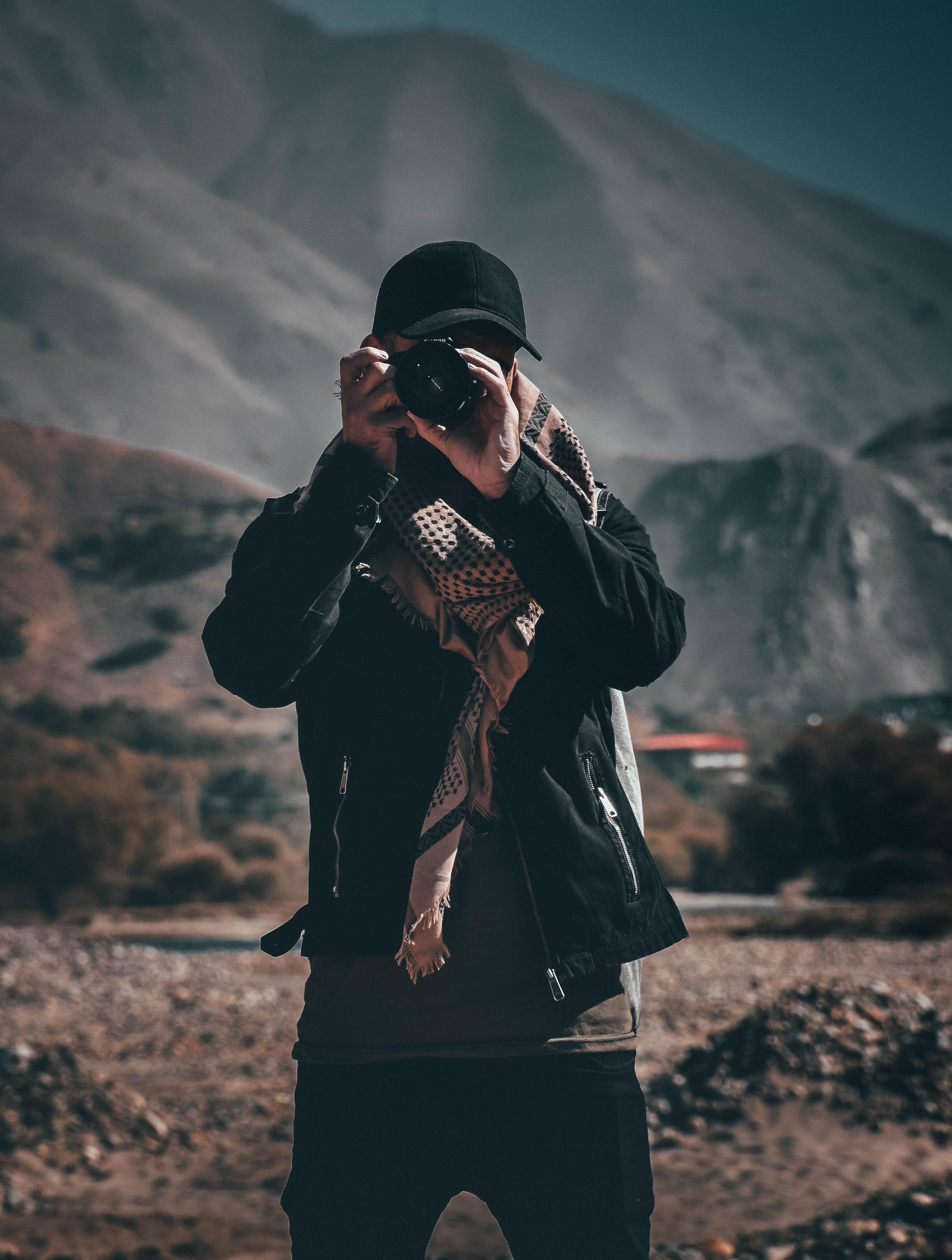 person-holding-camera-1704488