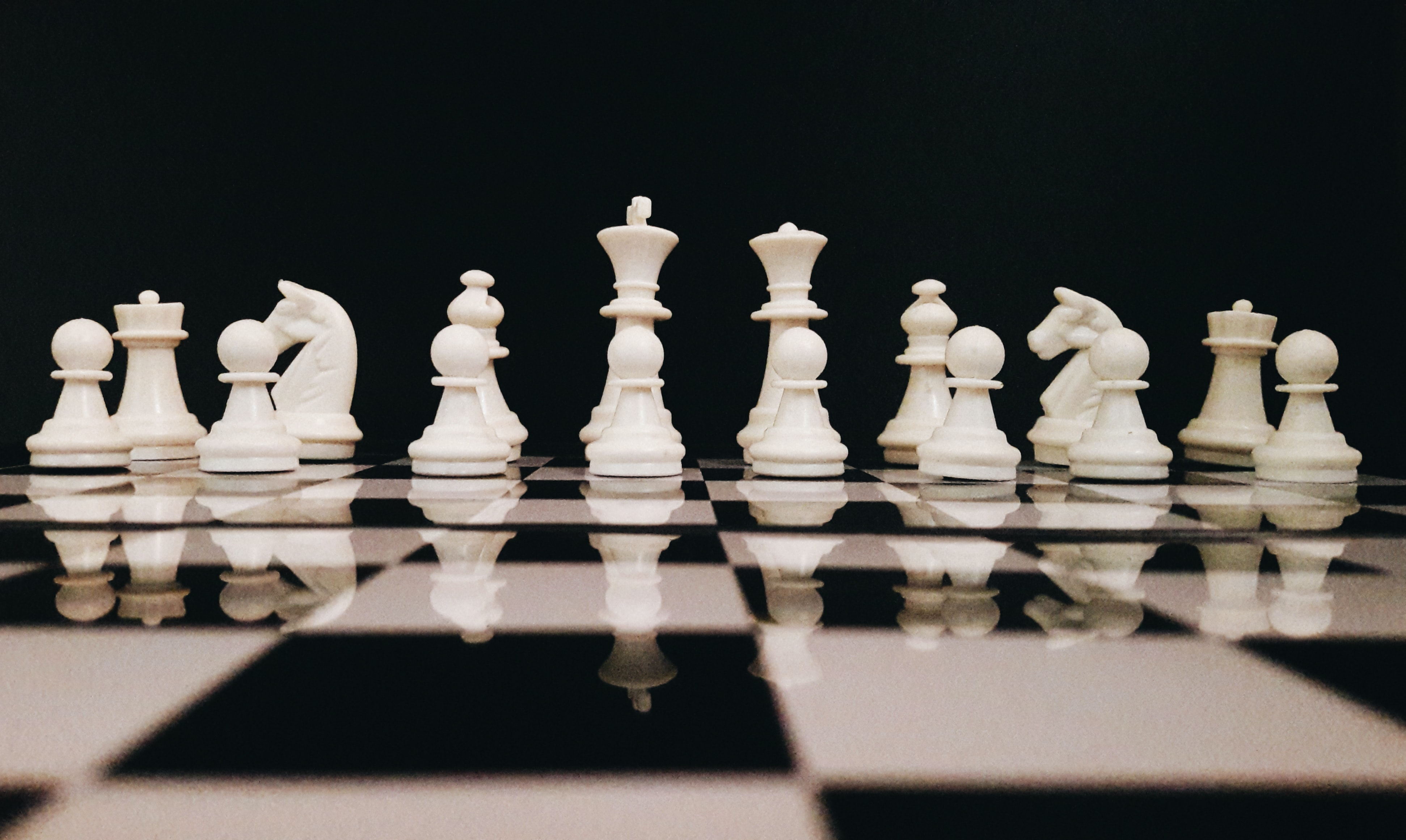 white-chess-piece-on-top-of-chess-board-