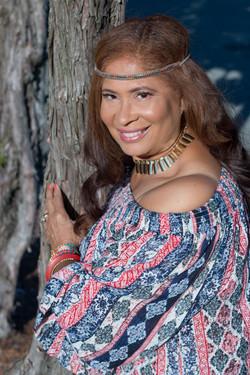 Woman Posing Next to Tree