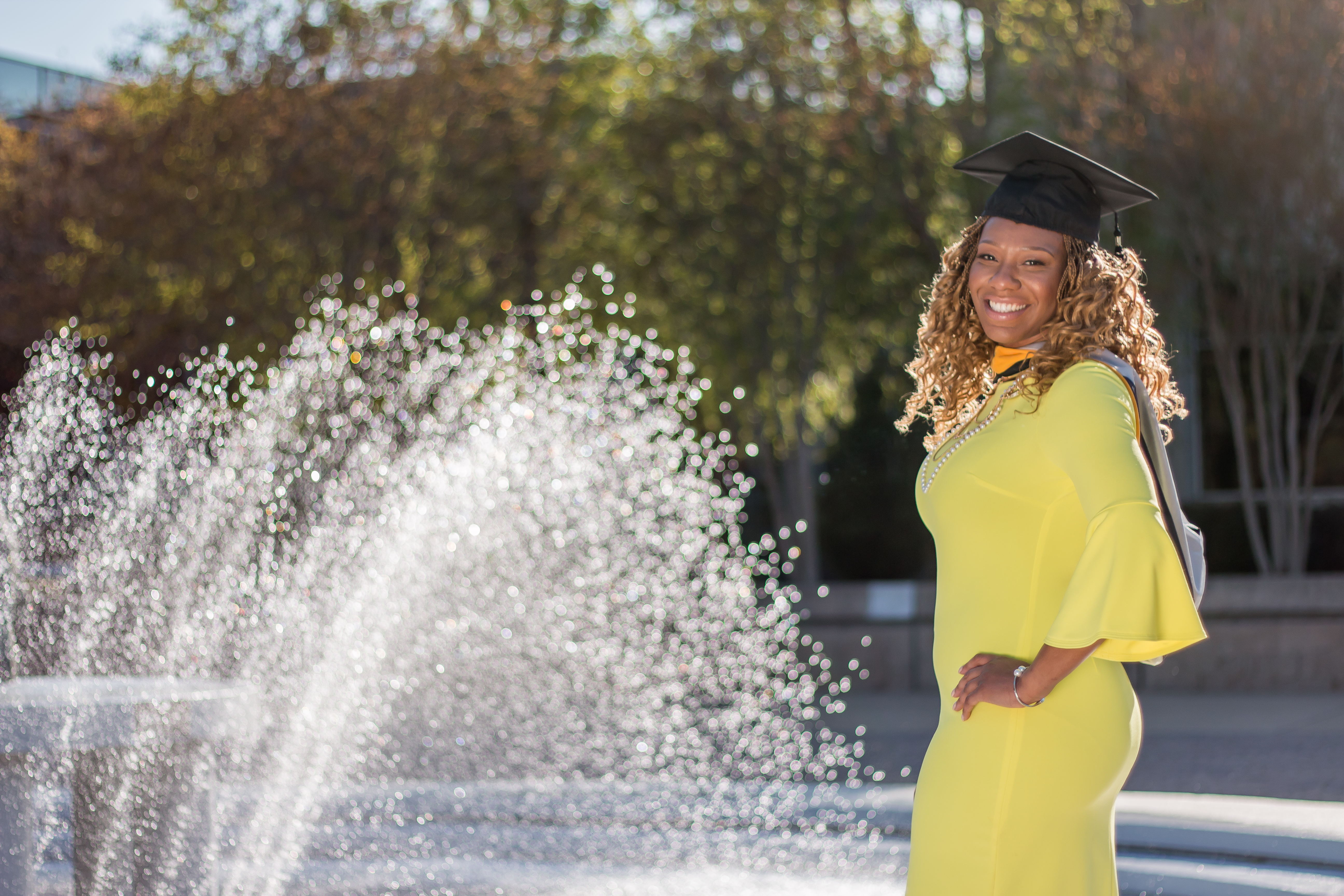 Grad Posing in Front of ODU Fountain