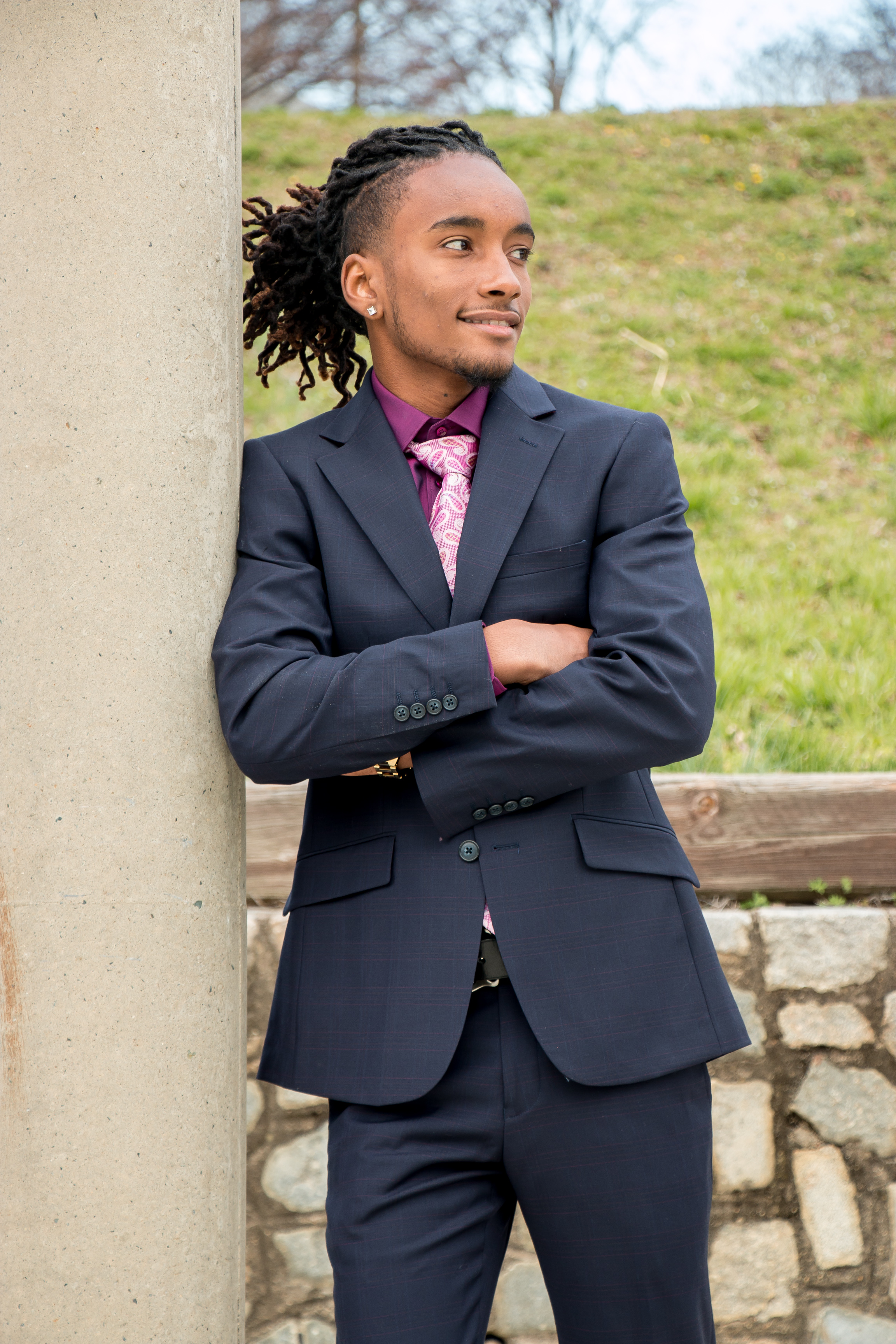 College Grad Posing in Suit and Tie