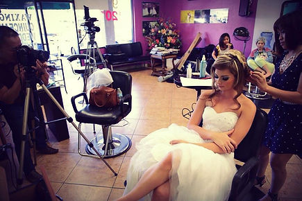 woman on white gown having hair done