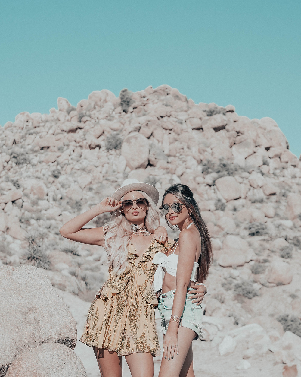 BFF Coachella inspiration in a flowy romper paired with oversized sunglasses. desert style. yellow romper