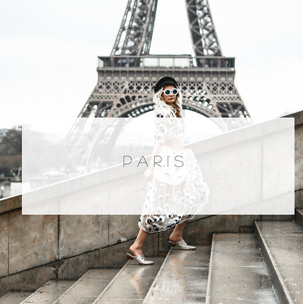 eiffel tower behind woman modeling