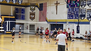 Official Manages Volleyball Game