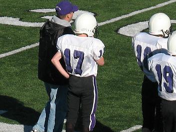 Coach instructing player