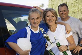 Family with happy athlete