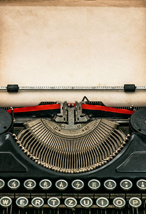 Antique typewriter with aged textured pa