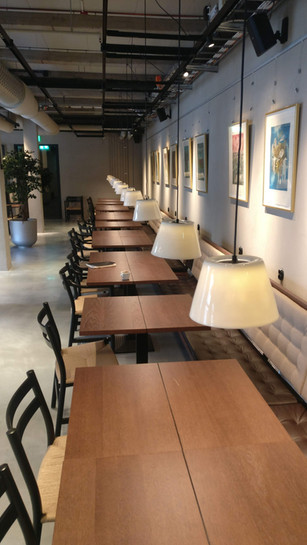 Restaurant oak wood tables and sofas